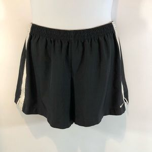 Nike Women's L black shorts white mesh trim